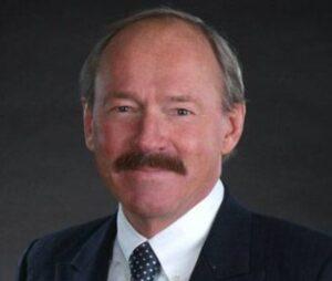 Jon Dellandrea photograph on dark background
